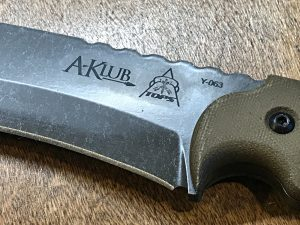 Closeup of the engraving on the blade of the A-Klub survivalist knife.