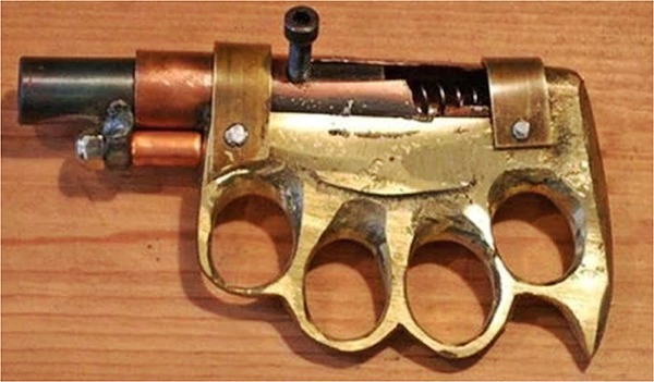 Brass knuckle handgun for brawling.