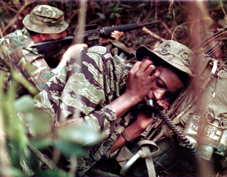 A Tigerstripe uniform (foreground) and ERDL pattern (background) in use by US forces in Vietnam, circa 1969. (Photo: Public Domain)