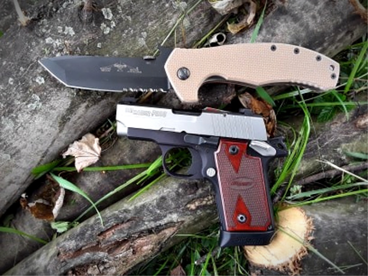 Emerson Roadhouse folding knife with handgun for EDC.