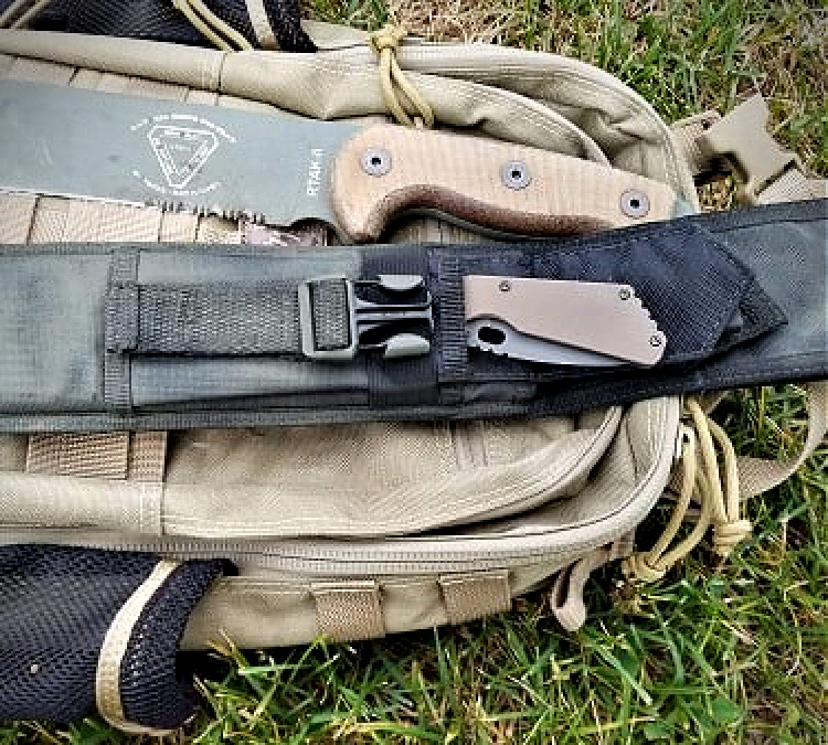 The front of the RTAK II sheath has a pocket for a knife or sharpener, complete with elastic securing band.