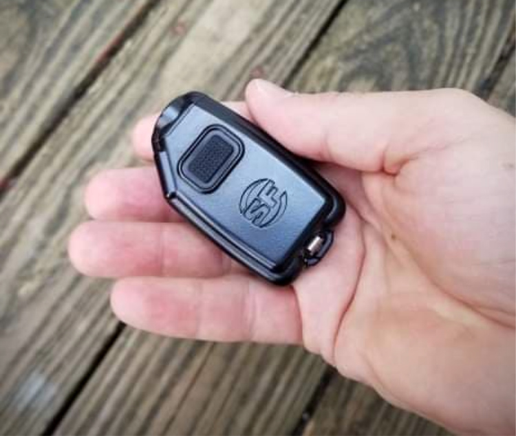 The Sidekick is small in the hand. The square button is the one used to switch on the light.