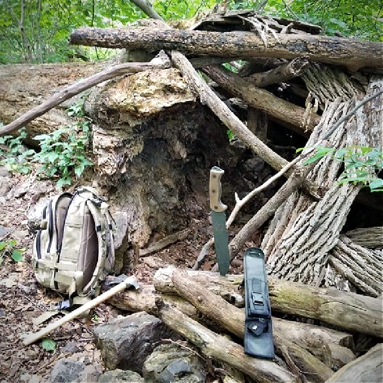 shelter building with RTAK II field knife.